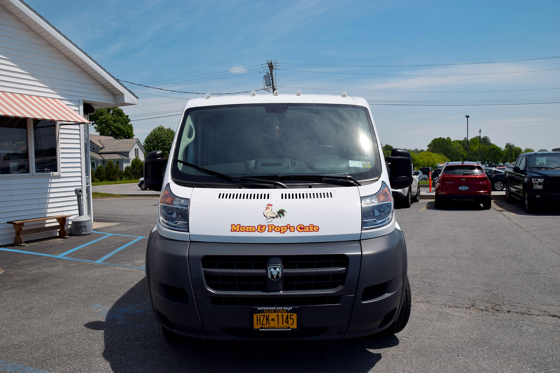 Photo of front of Mom and Pop's Cafe catering van with graphics designed and applied by SillyCar Design.