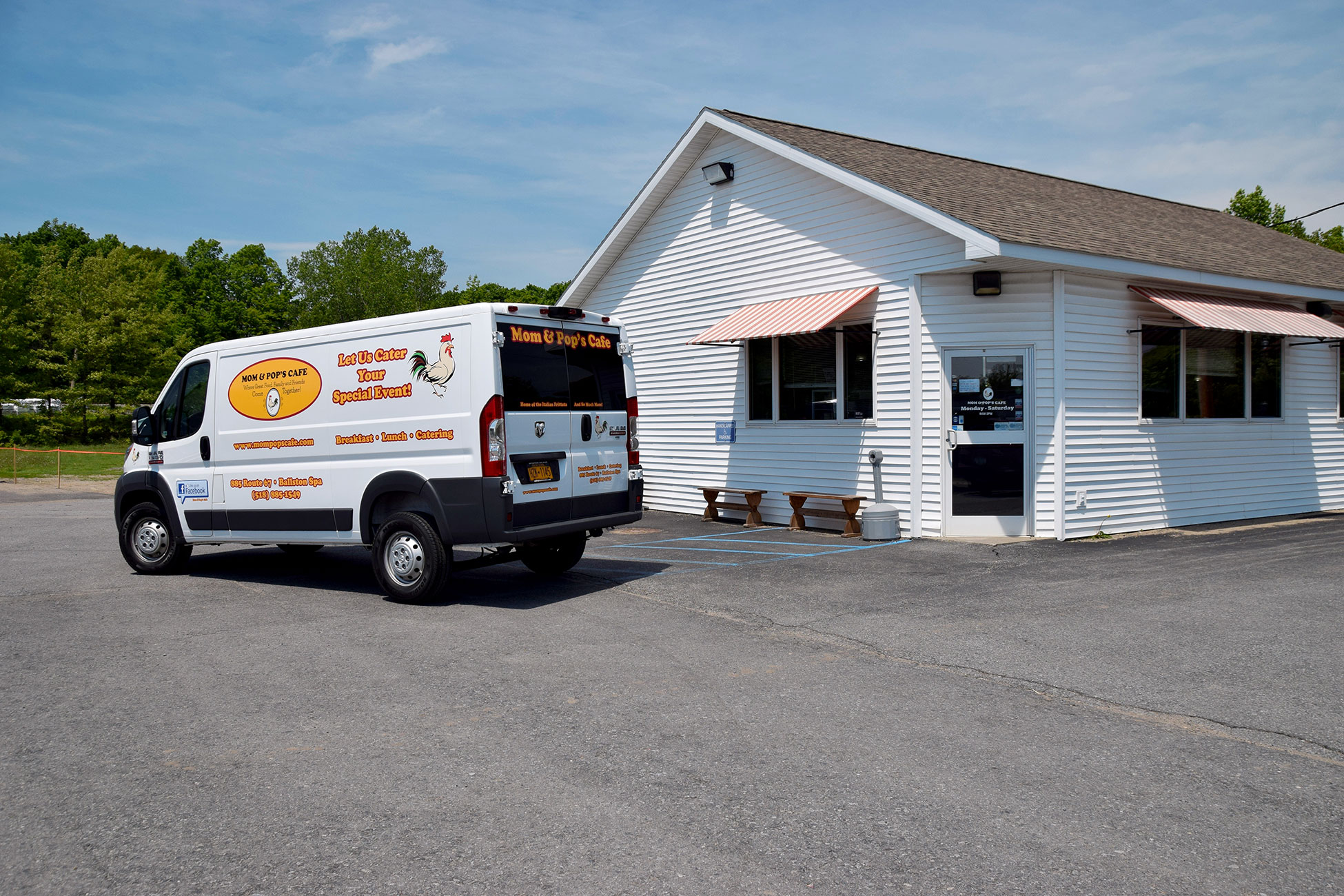 Photo of Mom and Pop's Cafe catering van with graphics designed and applied by SillyCar Design in front of the restaurant.