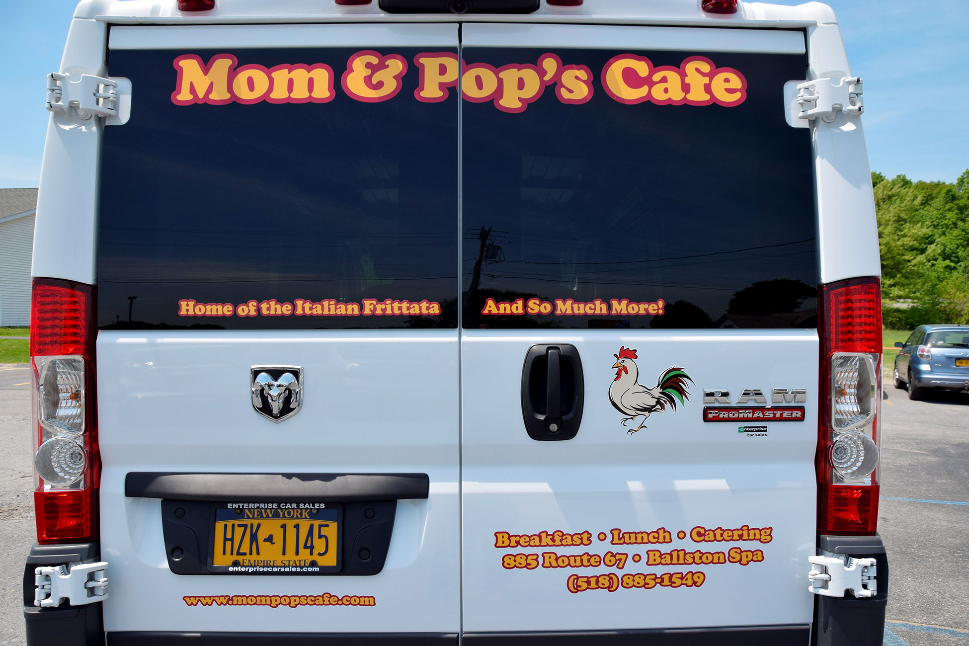 Photo of back doors of Mom and Pop's Cafe catering van with graphics designed and applied by SillyCar Design.