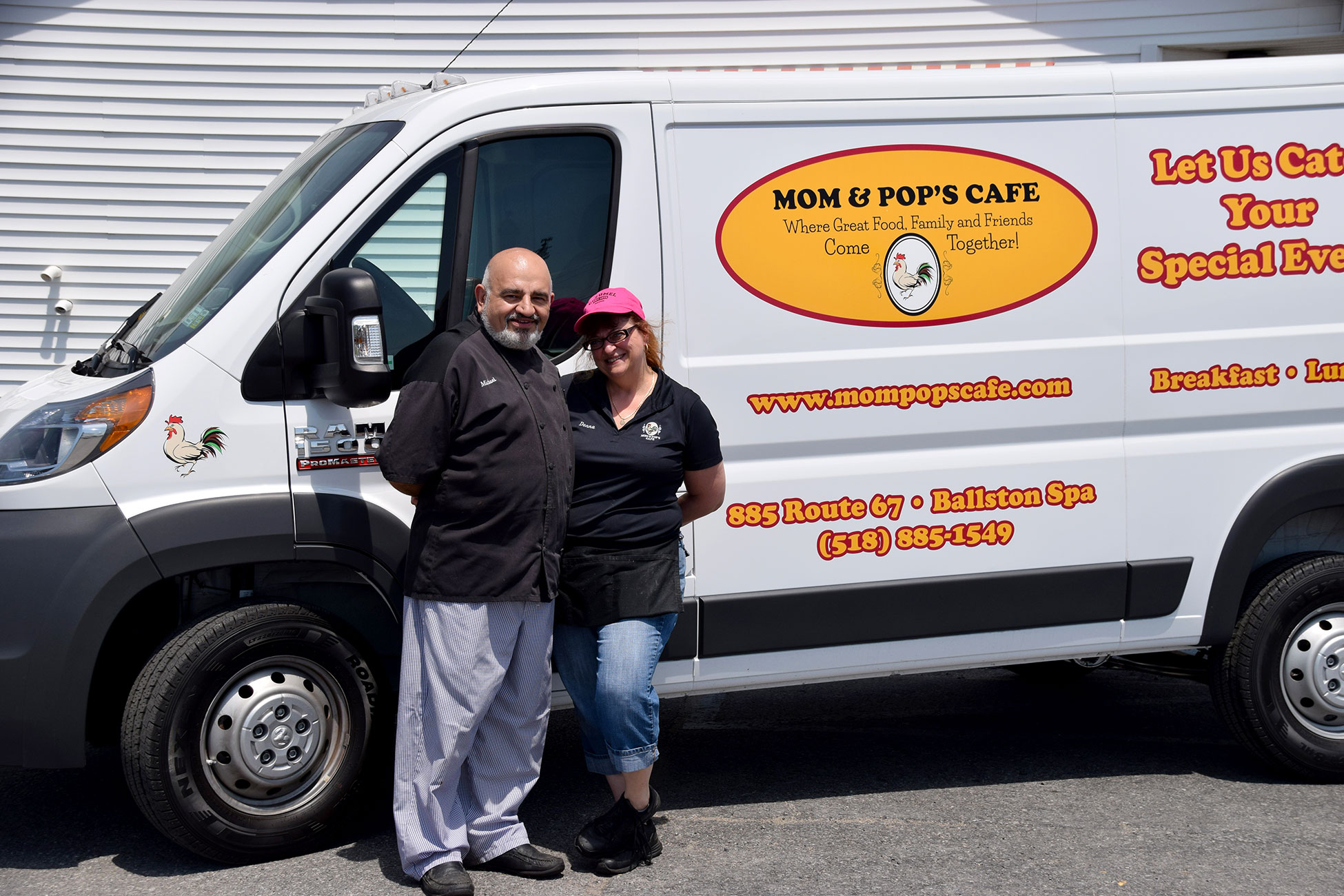 Photo of Mike and Donna Venturiello in front of their Mom and Pop's Cafe catering van with graphics designed and applied by SillyCar Design.