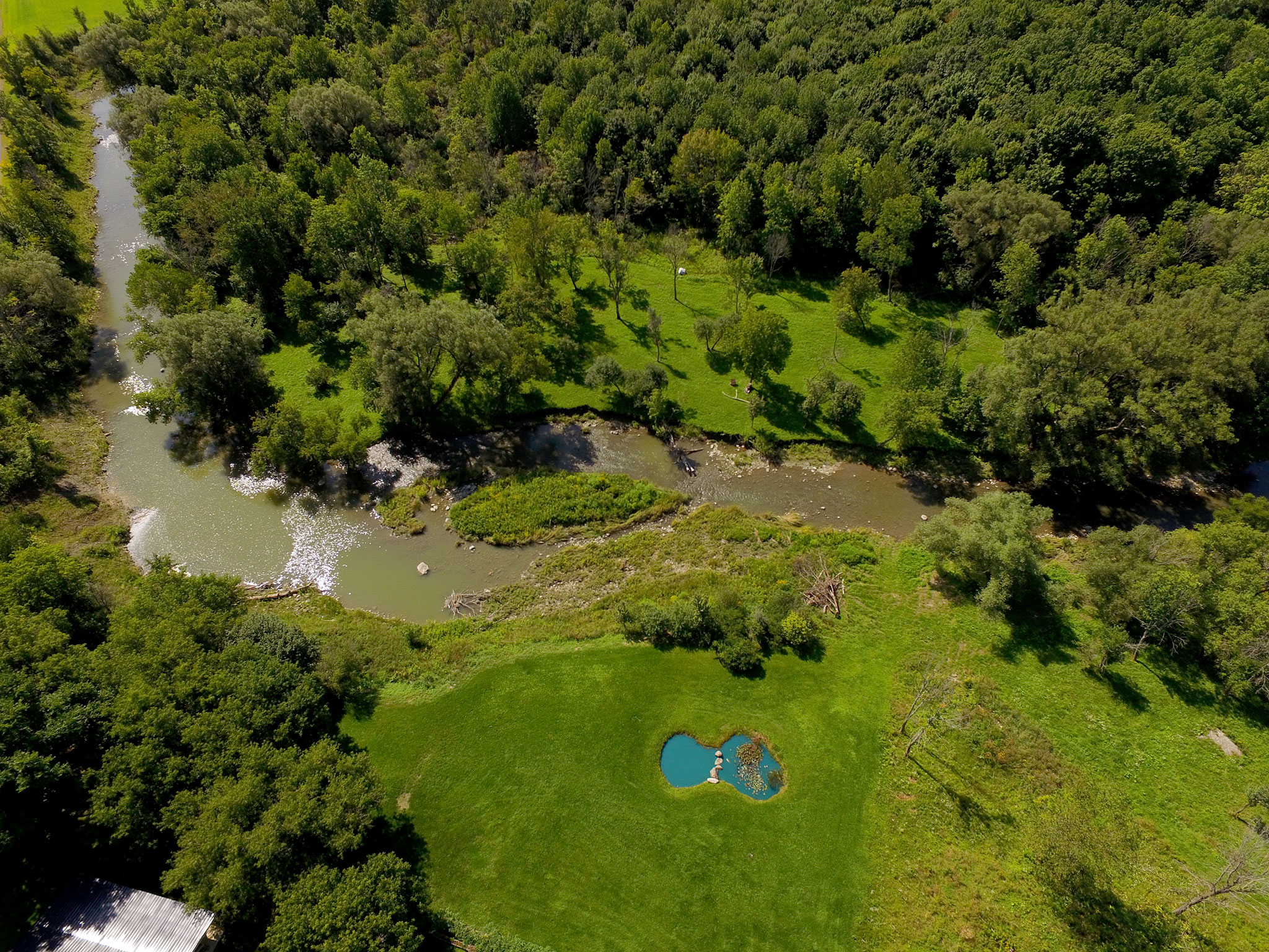 Aerial photo of straight down view of pond and creek at property in Canajoharie, New York.