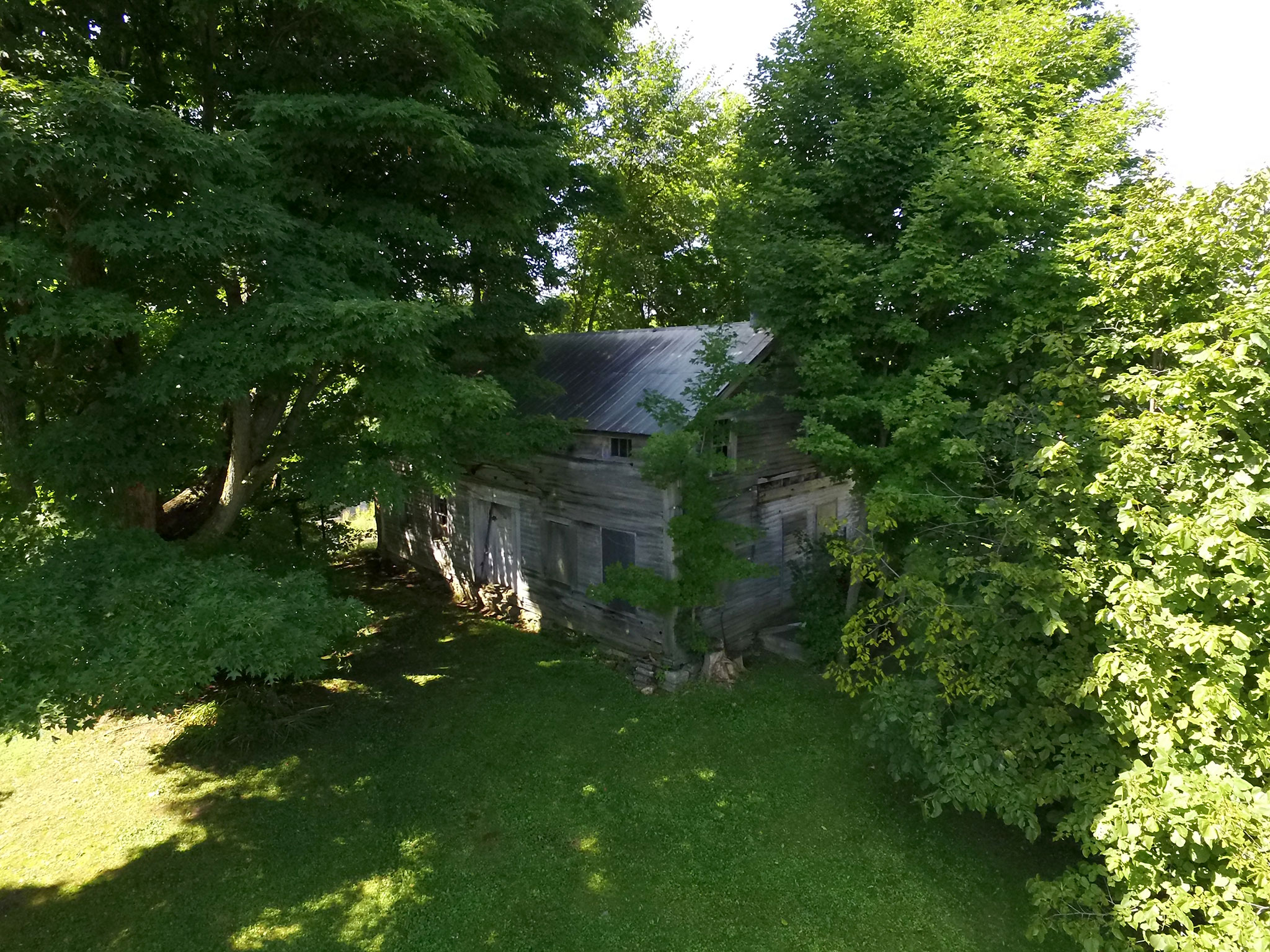Aerial photo of abandoned house at property in Canajoharie, New York.