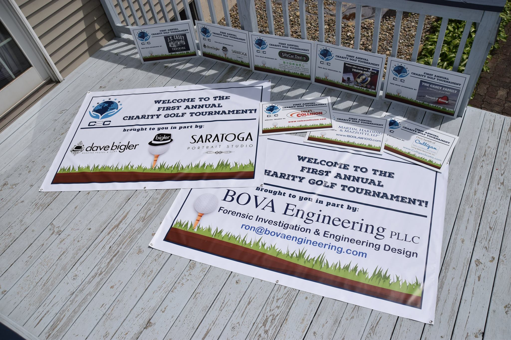 Photo of several tee signs and banners created for C2C first annual charity golf tournament.