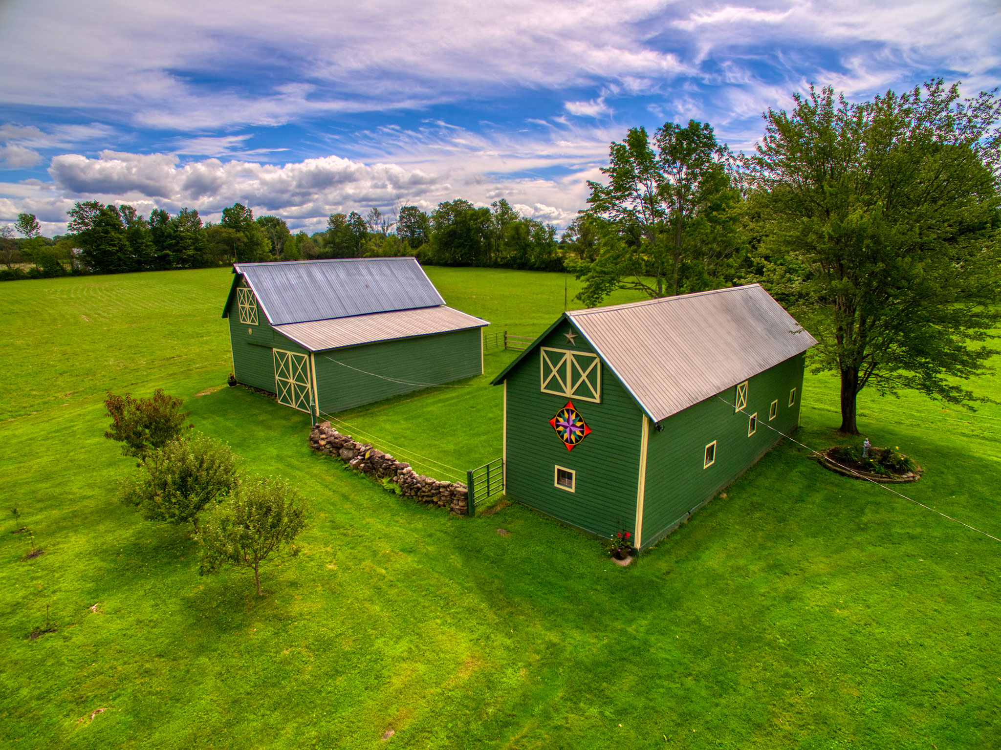 Aerial photo of two barns on property in Perth, New York.