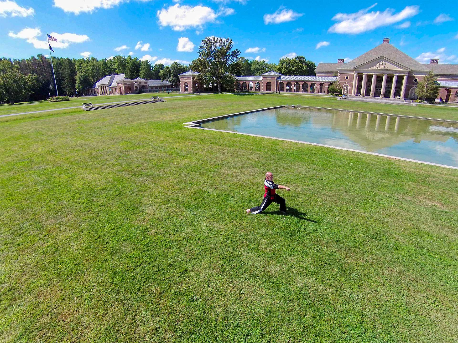 Aerial view of Sensei Jeff Melander performing a Karate Kata at the reflecting pool near the Hall of Springs in Saratoga, New York.