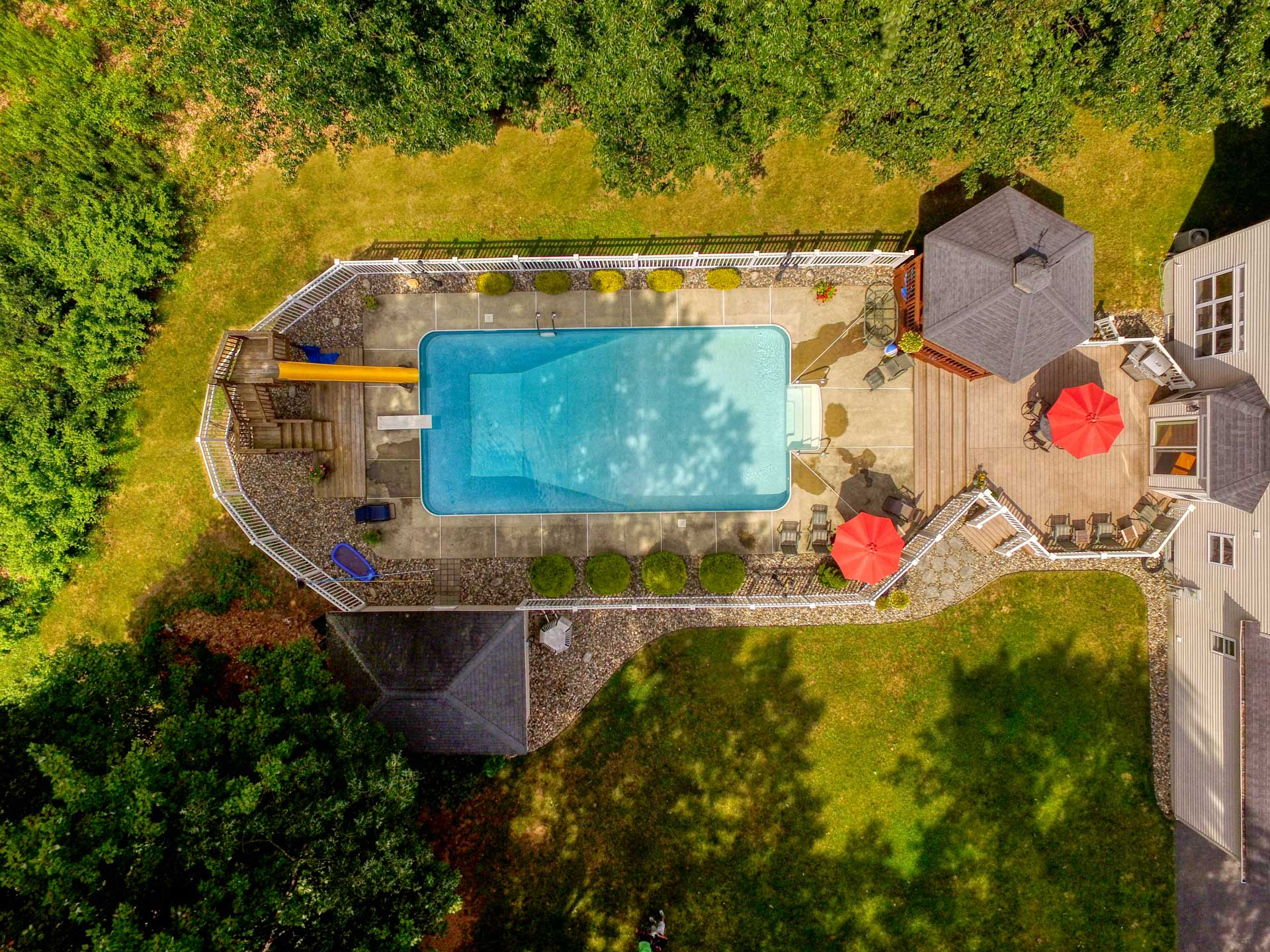 Aerial photo looking straight down at indoor pool in backyard of property in Ballston Spa, New York.